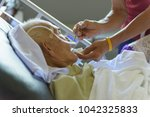 asian elder man sick and lay on ... | Shutterstock . vector #1042325833
