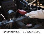 mechanic repairing a car  in... | Shutterstock . vector #1042342198