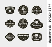 set of vintage brewery logos.... | Shutterstock .eps vector #1042345579