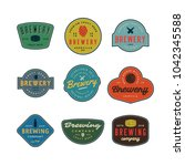 set of vintage brewery logos.... | Shutterstock .eps vector #1042345588