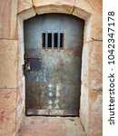 ancient prison cell at montju c ... | Shutterstock . vector #1042347178