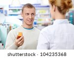 The pharmacist helps to choose a medicine man - stock photo