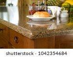 granite kitchen counter top... | Shutterstock . vector #1042354684