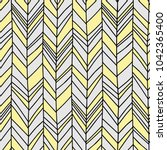 Seamless Boho Chevron. Hand drawn imperfect stripes in pale yellow and light to medium grey. Hot summer fashion trendy pattern. | Shutterstock vector #1042365400