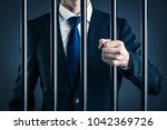 businessman and prison | Shutterstock . vector #1042369726