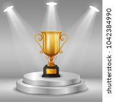 podium with trophy cup | Shutterstock . vector #1042384990