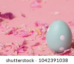 blue colored easter egg with... | Shutterstock . vector #1042391038
