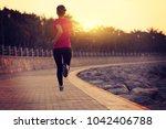 sporty fitness woman running on ... | Shutterstock . vector #1042406788