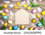 home symbol with easter eggs ...   Shutterstock . vector #1042408990