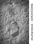 Small photo of Astronaut's boot print on lunar moon landing mission. Moon Surface
