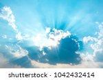 light sun pass cloud and sky... | Shutterstock . vector #1042432414