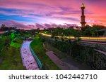 Small photo of Sunset sky at Gadjah Mada Mosque Tower, and Lembah River, Yogyakarta