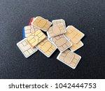 telecommunication sim cards | Shutterstock . vector #1042444753