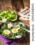 fresh spinach salad with eggs... | Shutterstock . vector #1042458043