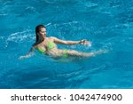 sexi lady swim on big waves of... | Shutterstock . vector #1042474900