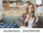 indoor lifestyle portrait of... | Shutterstock . vector #1042504558