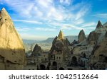 ancient dwellings carved inside ... | Shutterstock . vector #1042512664