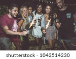 group of friends making... | Shutterstock . vector #1042514230