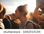 festival crowd  young man with... | Shutterstock . vector #1042515154