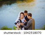 photographer showing the bride... | Shutterstock . vector #1042518070