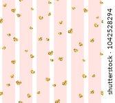 gold heart seamless pattern.... | Shutterstock .eps vector #1042528294
