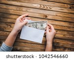 a money note in a white... | Shutterstock . vector #1042546660