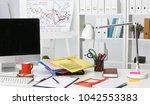office desk a stack of computer ...   Shutterstock . vector #1042553383