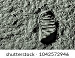 Small photo of Buzz Aldrin's footprint on the moon. Astronaut's boot print on lunar moon landing mission. Moon Surface