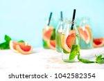 pink grapefruit and fresh basil ... | Shutterstock . vector #1042582354