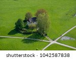 aerial view house on lawn is... | Shutterstock . vector #1042587838