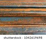 rustic metal from oxidation... | Shutterstock . vector #1042619698
