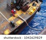 marine crew pulling mooring...   Shutterstock . vector #1042629829