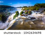 landscape of the iguazu... | Shutterstock . vector #1042634698