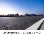 empty road with moden building... | Shutterstock . vector #1042634740