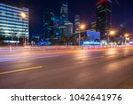 busy traffic with moden building | Shutterstock . vector #1042641976
