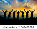friends silhouette holding hand ... | Shutterstock . vector #1042673209