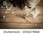 drugs  powder  syringe and... | Shutterstock . vector #1042674868