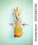 party pineapple over blue... | Shutterstock . vector #1042683760