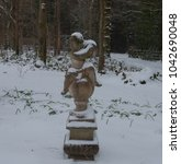 Stone Statue Covered In Snow I...