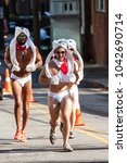 Small photo of Atlanta, GA / USA - December 9, 2017: A group of men wearing speedos and polar bear hats and mittens, run in the Santa Speedo Run, a charity fundraiser on December 9, 2017 in Atlanta, GA.
