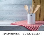 kitchen utensils on wooden...   Shutterstock . vector #1042712164