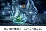 Small photo of Two Astronauts Analyzing Plant Life Found on Alien Planet. Infographics Show Animated Data about Oxygen Generation, DNA and Molecular Structure. Technological Advance and Space Exploration.