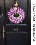 Black Door With Purple And...