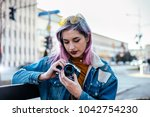 girl photographer with lilac... | Shutterstock . vector #1042754230