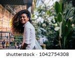portrait of a beautiful girl... | Shutterstock . vector #1042754308