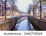 canal in gouda at dawn. gouda ... | Shutterstock . vector #1042778569