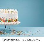 white birthday cake with... | Shutterstock . vector #1042802749