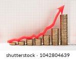 close up of increasing golden... | Shutterstock . vector #1042804639