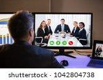 rear view of a businessman... | Shutterstock . vector #1042804738