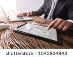 close up of a businessman's... | Shutterstock . vector #1042804843